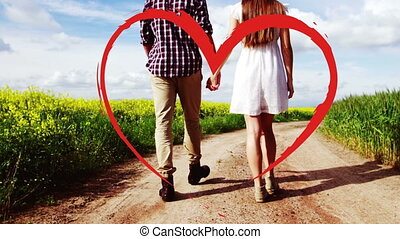 Couple walking in the countryside while holding hands for valentine day