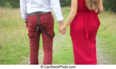couple walking in the forest hand - Start a romantic...
