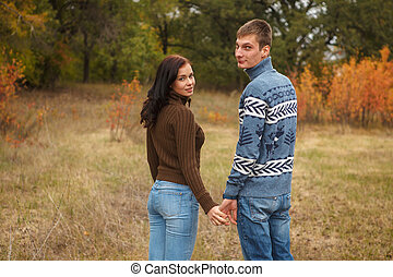couple walking in the park outdoors