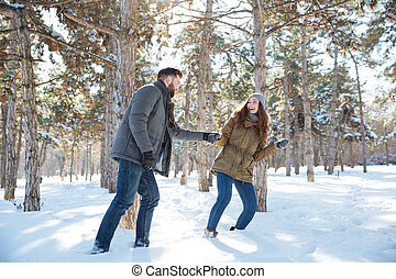 Couple walking in the winter park