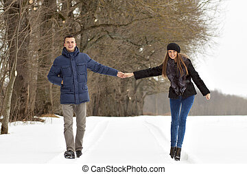 Couple walking in winter park