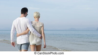 Couple Walking On Beach Embracing Back Rear View, Man And...