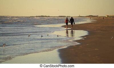 Couple Walking on Beach South Padre Island Texas - The Gulf...