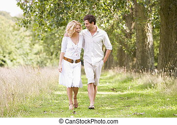 Couple walking on path smiling