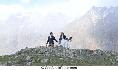 Couple walking on the fog and mountains background