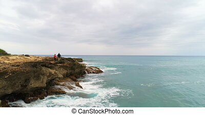Couple walking on the rocky sea coast 4k - Carefree couple...