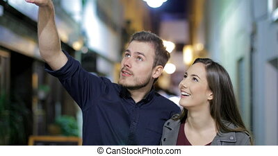 Couple walking sightseeing in the night in the street