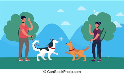 couple walking with dogs in the park
