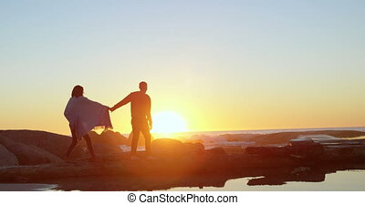 Couple walking with hand in hand on rocky shore 4k - Couple ...