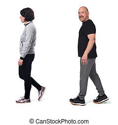couple walking with in sportswear on white background.