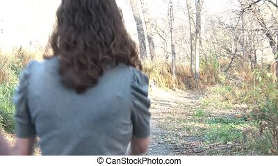 Couple Walks in Fall Landscape