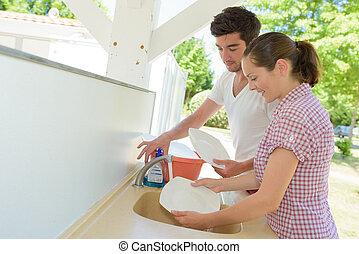 couple washing up the dishes