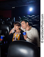 Couple Watching Movie In Cinema Theater