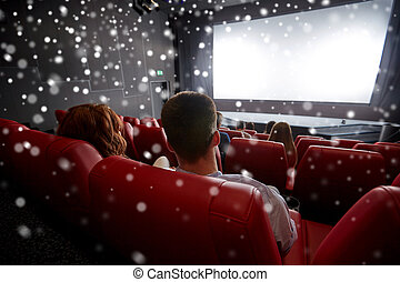 couple watching movie in theater or cinema