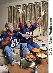 Couple watching sports.