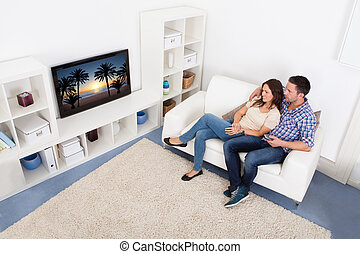 Couple Watching Television - Happy Young Couple In...