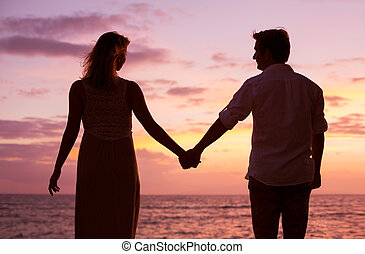 Couple watching tropical sunset