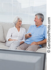 Couple watching tv on the couch