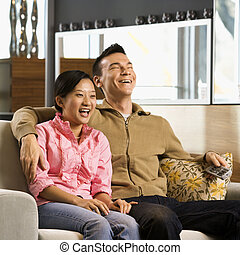 Couple watching TV.
