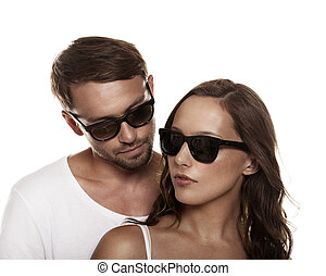 Couple wearing sunglasses isolated over a white background