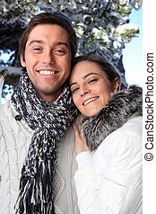 Couple wearing winter clothing