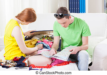 Couple while packing for vacation
