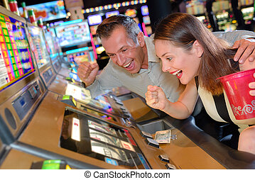 Couple willing slot machine victory
