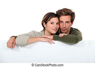 Couple with a board left blank for your message