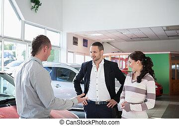 Couple with a car dealer