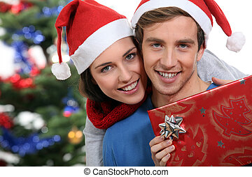 Couple with a Christmas gift