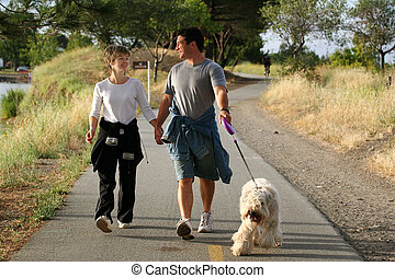 Couple with a dog - Couple walking their dog