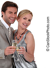 Couple with a glass