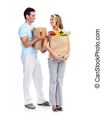 Couple with a grocery bag.