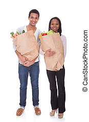 Couple With A Grocery Bag