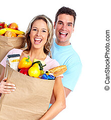Couple with a grocery bag. Isolated over white background.
