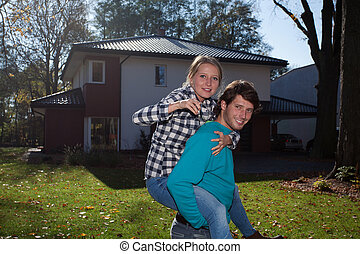 Couple with a keys to new house