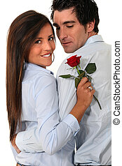 Couple with a red rose