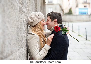 couple with a rose kissing on valentines day