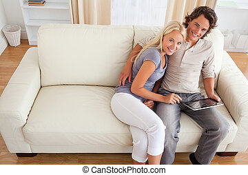 Couple with a tablet computer