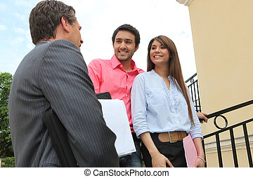 Couple with an estate agent