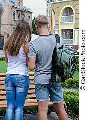 Couple with backpack looking at map