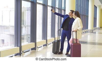 Couple with baggage in international airport. Man and woman going on landing