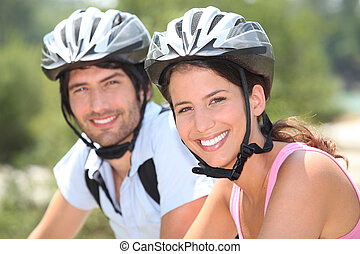 Couple with bicycle helmet
