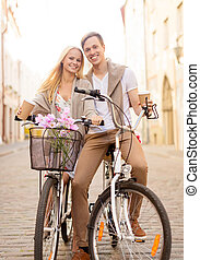 couple with bicycles in the city - summer holidays, bikes,...