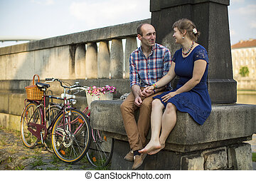 Couple with bicycles sitting