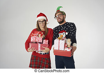 Couple with big stack of Christmas presents
