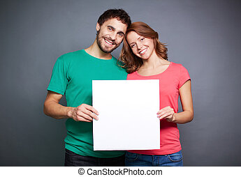 Couple with blank paper