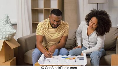 couple with blueprint and color palettes at home