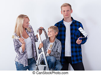 Couple with child during home renovation, horizontal