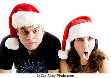couple with christmas hat and making faces